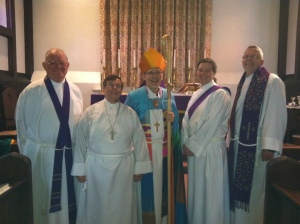 Bishop Steve Lane's (center) visitation to St. Peter's in Portland, Maine on December 9, 2012. With him (l-r) The Rev. Ben Barnes, regular supply priest; Robert Sherwood, Senior Warden; the Rev. Kelly Moughty, assistant priest; and the Rev. Larry Weeks, priest-in-charge.
