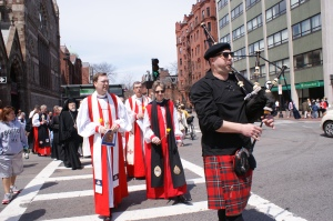 The Presiding Bishop, Bishop Knisely of Rhode Island, and other denominational leaders process across Copley Square from Old South Church to Trinity Church.