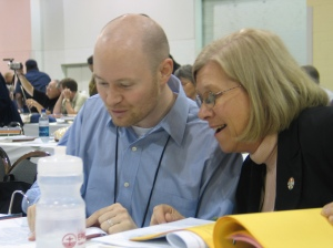As clergy and lay alternates at the 2006 General Convention in Columbus, Ohio,  the Rev. Calvin Sanborn and Vicki confer or goof off. It's hard to tell.